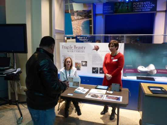 A guest learns about shipping invasives from Monica Noble (NMNH) and Katrina Lohan (SERC)