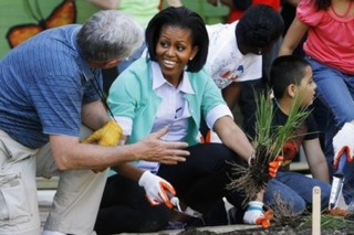 Christopher Puttock planted a native butterfly garden with first lady Michelle Obama at the Marie H. Reed Community Learning Center on April 29, 2010.