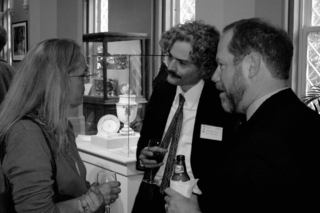 Clem Hamilton (right) talks with Holly Shimizu and Daniel Martin Varisco during a reception at the United States Botanic Garden. (Photo by Elaine Haug)