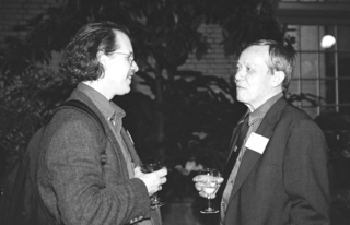 George Schatz (left) and Dennis Stevenson enjoying the reception at the United States Botanic Garden. (Photo by Leslie Brothers).