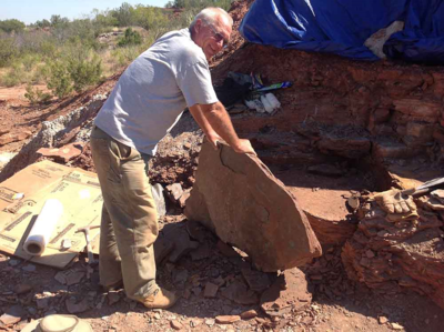 Dan Chaney holds up a large slab of rock excavated from the quarry