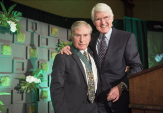 Sy Sohmer (left) receives the International Award of Excellence in Conservation from Edward Bass, Vice Chair of the BRIT Board of Directors. (photo courtesy of BRIT)