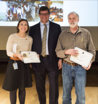 "Melinda Peters (left) and Tom Hollowell (right) receive the ""Conserving Traditional Languages Award"" from NMNH Sant Director Kirk Johnson. (photo by the Smithsonian Institution)"