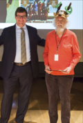 "Jim Harle (right) receives the ""Volunteer Excellence Award"" from NMNH Sant Director Kirk Johnson. (photo by the Smithsonian Institution)"