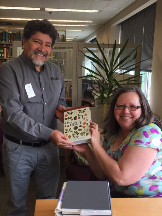 Gorky Villa presents Robin Everly with a copy of Common and Conspicuous Trees of Yasuni. (photo by Ida Lopez)