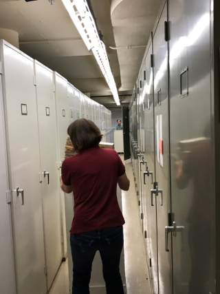 Mark Strong and Carol Kelloff shift herbarium folders during their off hours to help make way for the rearrangement of the herbarium into a modified APG-IV format.