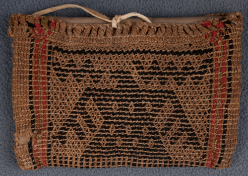 Twined Potawatomi bag with indigenous bast fibers, dyed commercial wool fibers, and hide (NMAI 2/7533).
