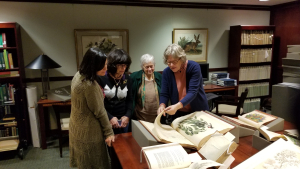 Leslie Overstreet highlights special notations in a botanical book on commercially important plants on display at the Cullman Rare Book Library. (photo by Allie Alvis)