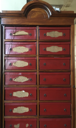 Kossuth's collections are housed in red boxes. (photo by Julia Beros)