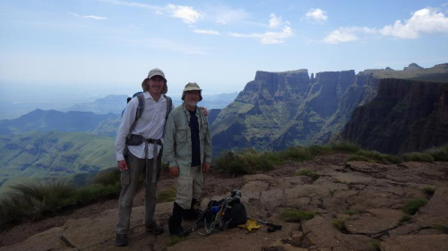 Steven Sylvester (left) and Rob Soreng in the Drakensberg Mountains, Afroalpine grassland, Tugela Plateau with a view of Devil's toothpick, Kwazulu-Natal Province, South Africa. (photo by anonymous tourist using Rob Soreng's camera)