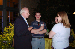 Harold Robinson speaking with attendees of the 2005 Smithsonian Botanical Symposium during a reception at the U.S. Botanic Garden. (photo by Leslie Brothers)