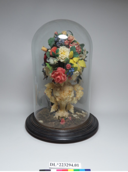 A wax bouquet from the National Museum of American History, with was flowers depicting roses, lilies, carnations, dahlias, hydrangeas, lilies-of-the-valley, peonies, Virginia bluebells and more, c. 1859-1865.